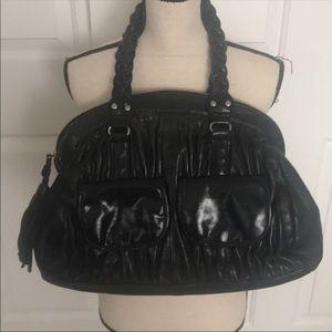 Beautiful all leather BCBG black bag. Great bag!